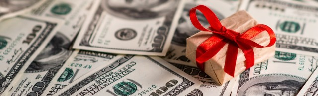 Gift box and US dollar bills; Shutterstock ID 161122271; PO: aol; Job: production; Client: drone